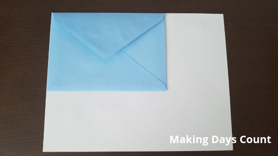 Measure envelope against white paper