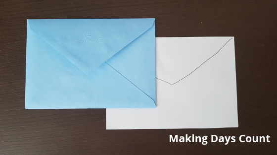 Cutting the white paper to match the envelope