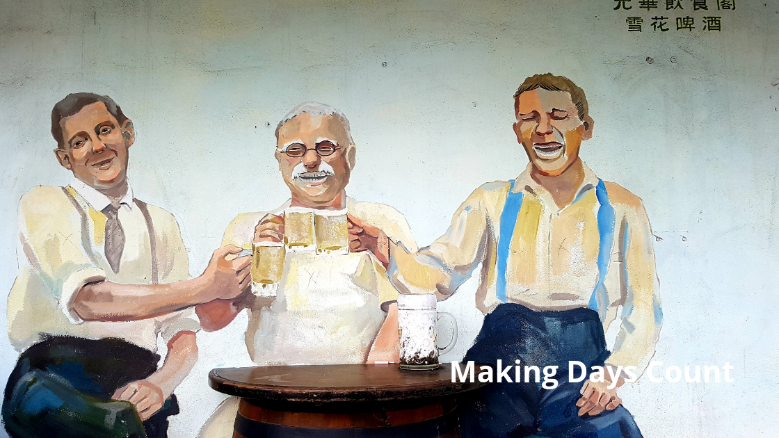 Mural of 3 men drinking