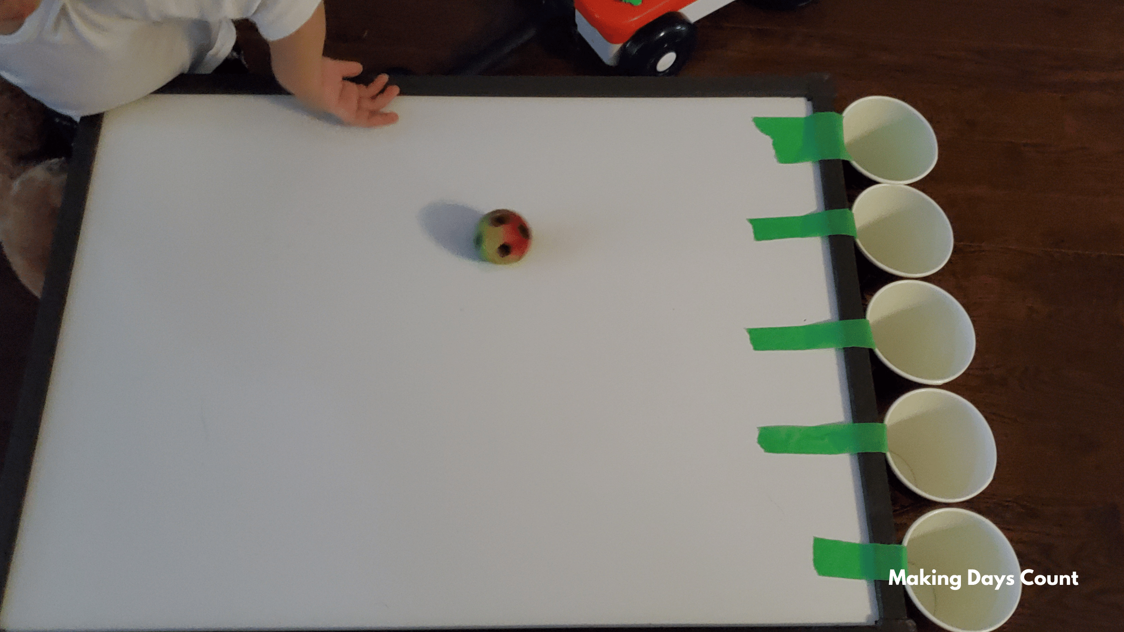 Indoor Toddler Activities: Cups and a Ball